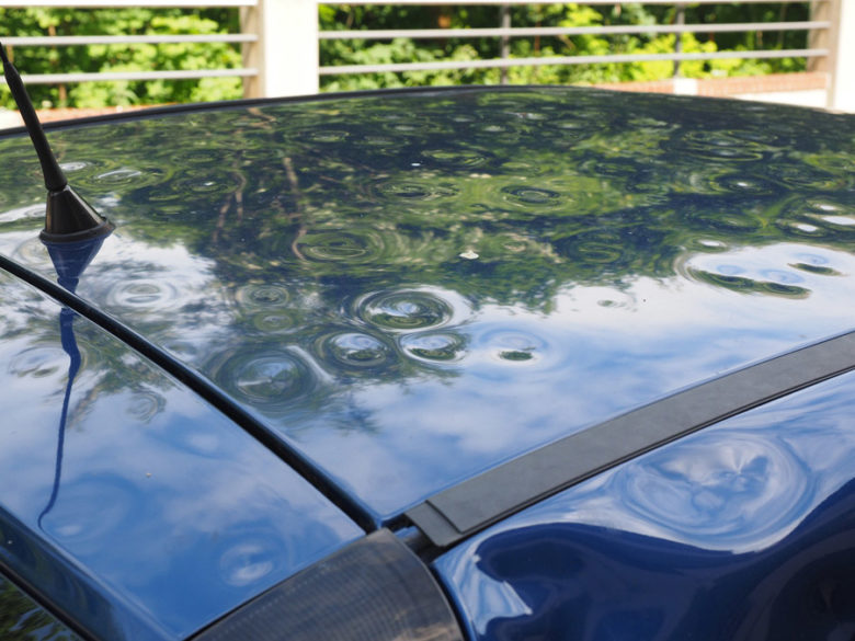 Hail damage on car roof, needing auto dent repair in Carrollton, Texas